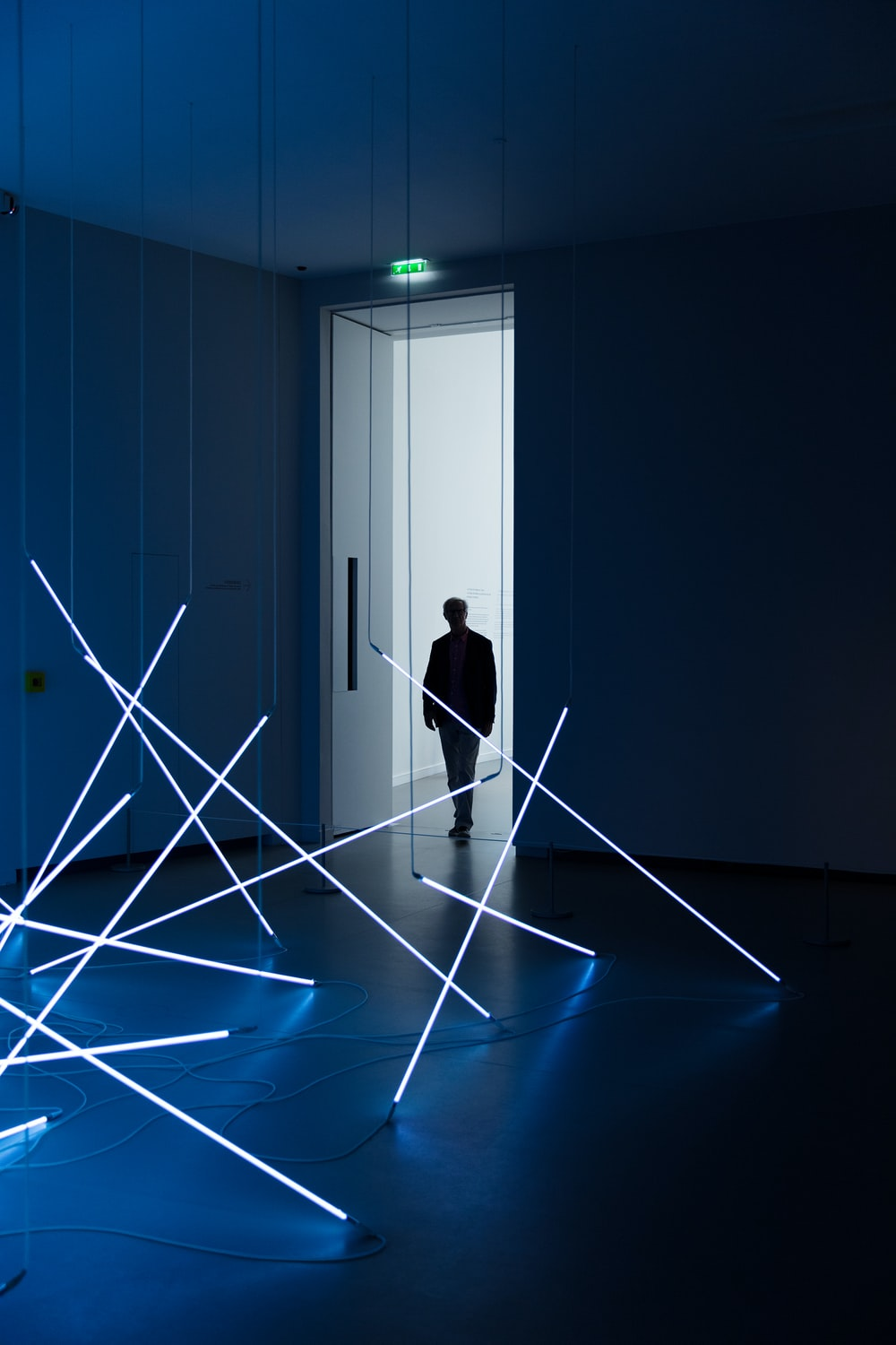person at a white room with flourescent lights