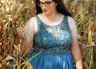 blue floral crew-neck tank dress standing between corn plants