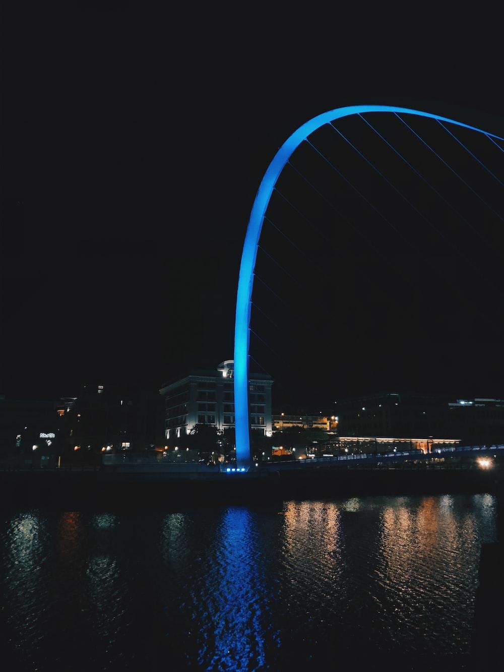 blue-lighted landmarj at night