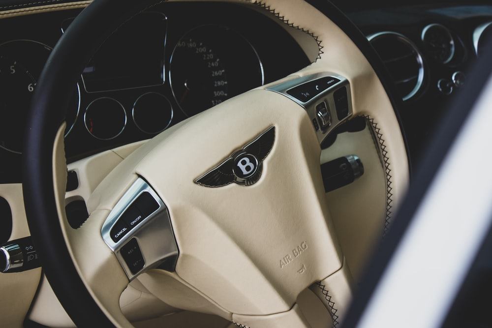 beige and black Bentley car steering wheel