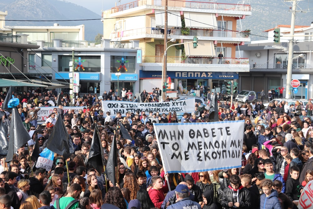 people gathered in the streets in a rally