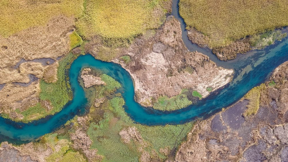 aerial photography of winding river