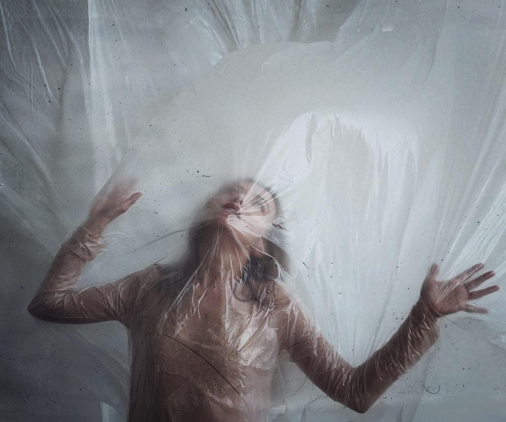 woman in a plastic sheet