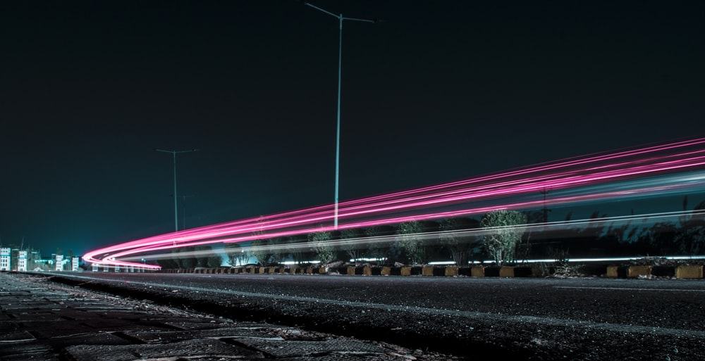 time lapse photography of passing cars in the street during nighttime