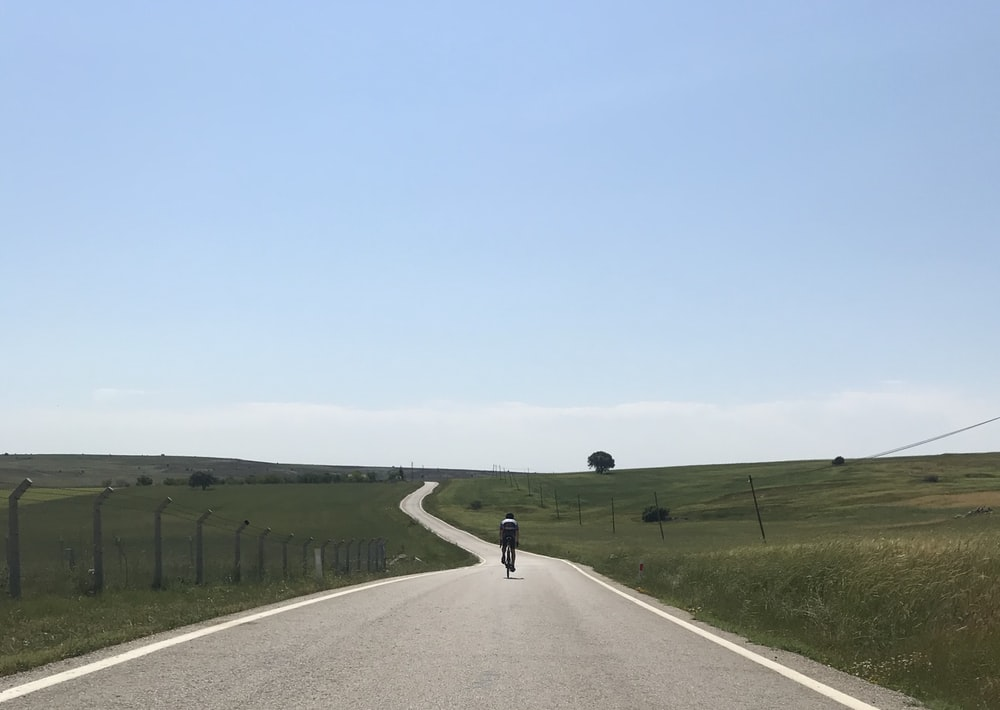 person riding bicycle in the road