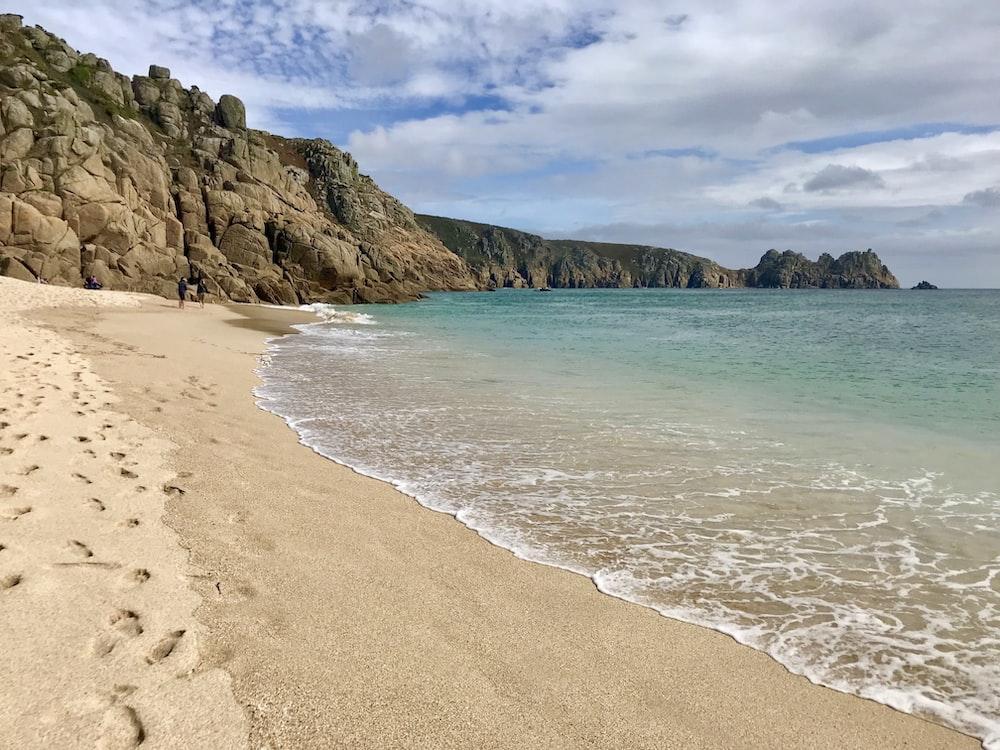 wavy seashore during daytime
