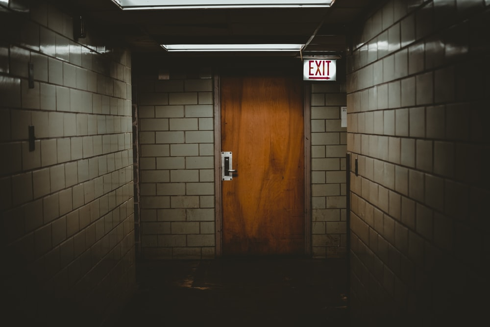 shallow focus photo of brown wooden door