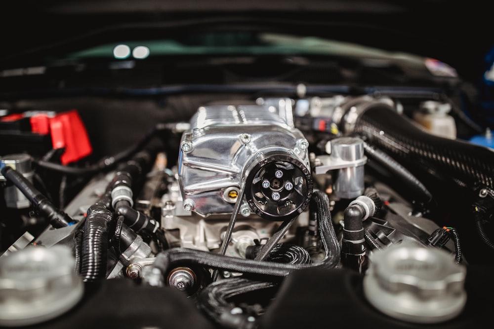 shallow focus photo of car engine bay