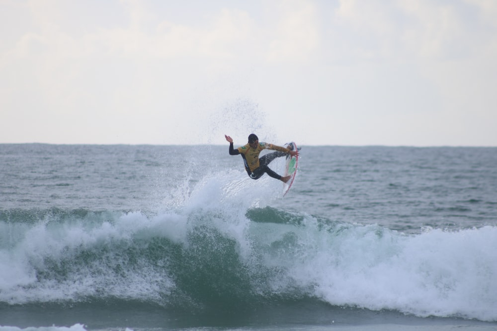 person riding surfboard