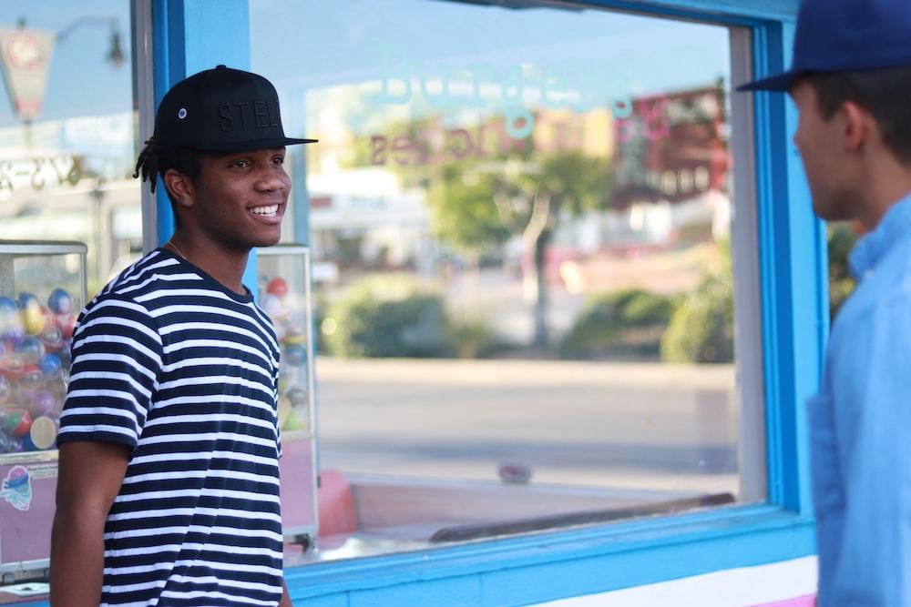 man leaning on glass window