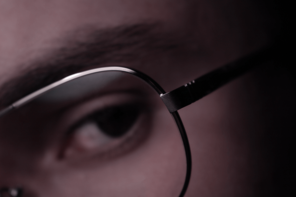 photo of person wearing eyeglasses