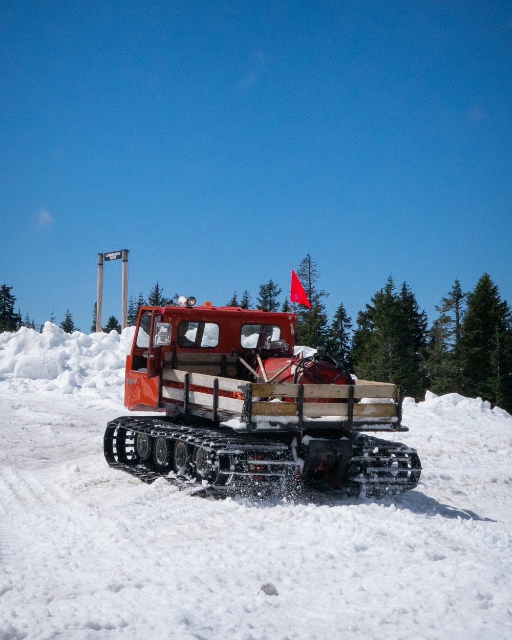 red and black snow truck