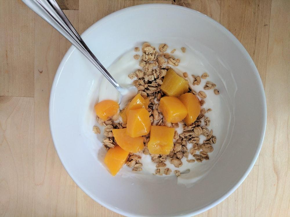 cereal with milk in ceramic bowl