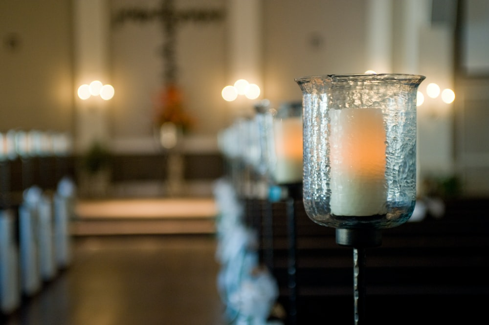 selective focus photography of candles on stand