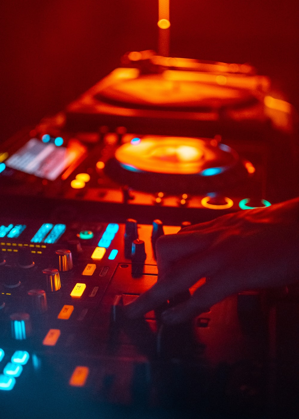 shallow focus photography person playing DJ controller