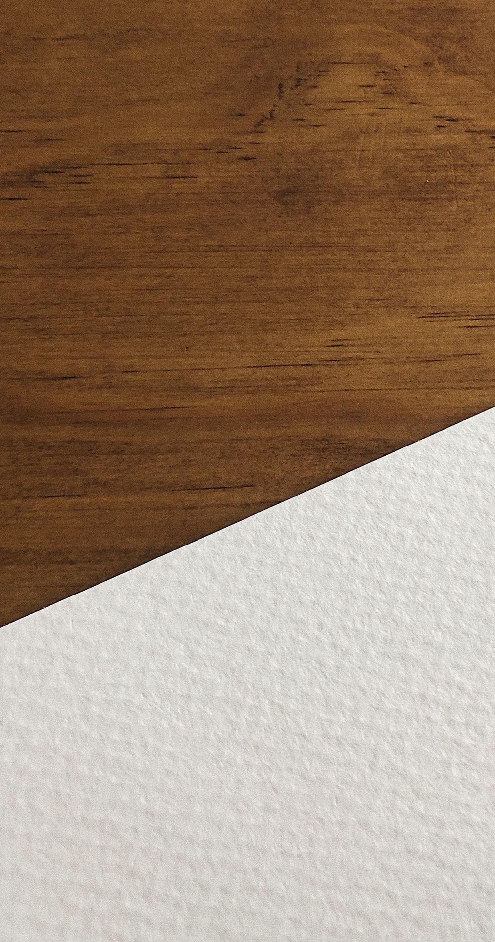 white paper on brown wooden surface