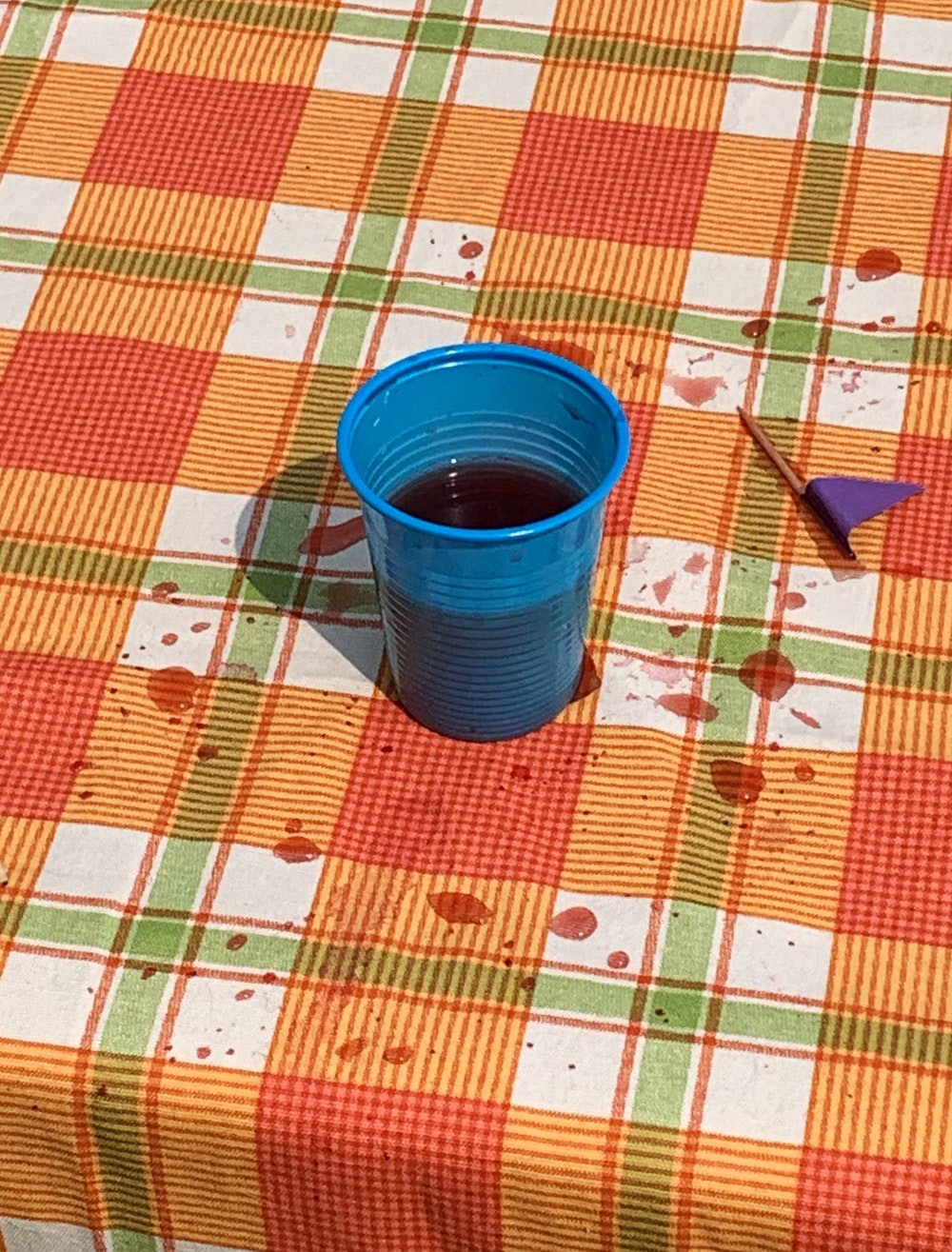 blue cup on table