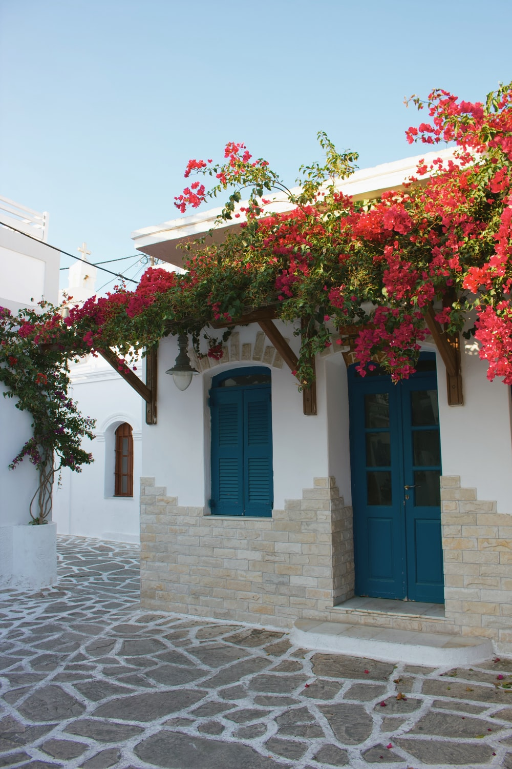 house with awning and flowers during day