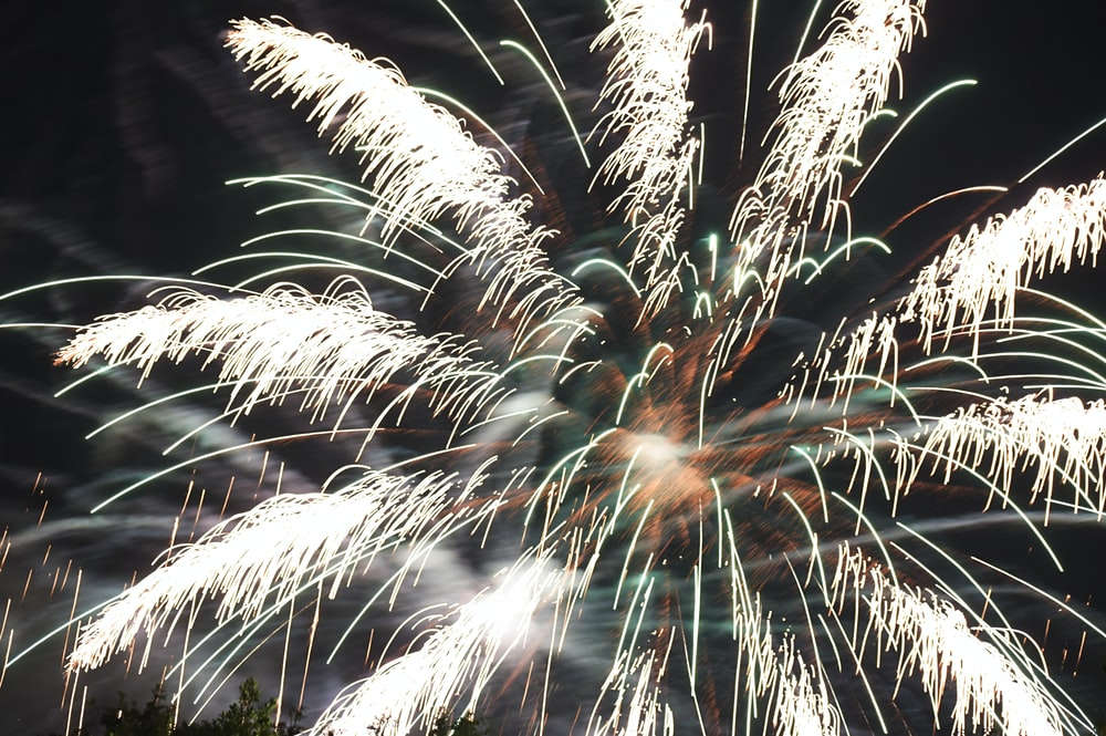 time lapse photography of bursting fireworks