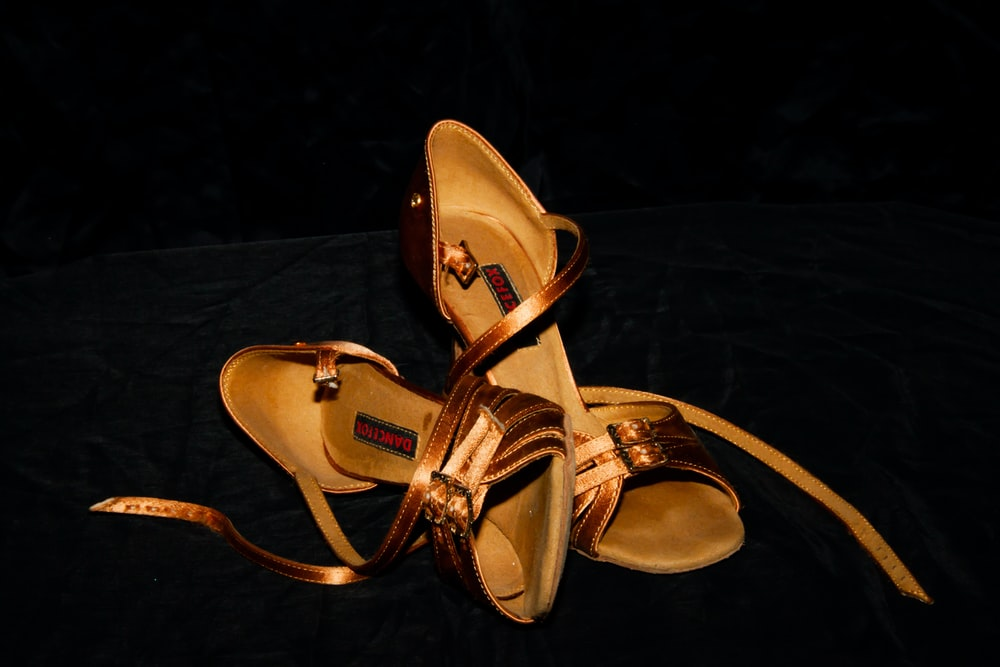 pair of brown heeled sandals
