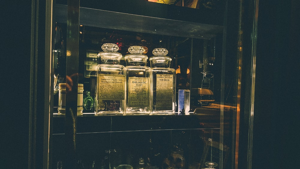 clear glass jars inside display cabinet