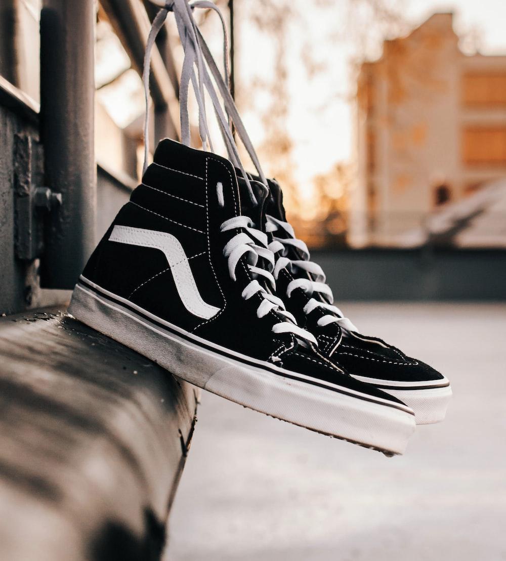 black-white Vans high-top sneakers