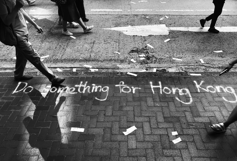 grayscale photography of do something for Hong Kong road text