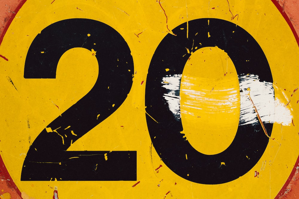 round yellow and black 20 text signboard