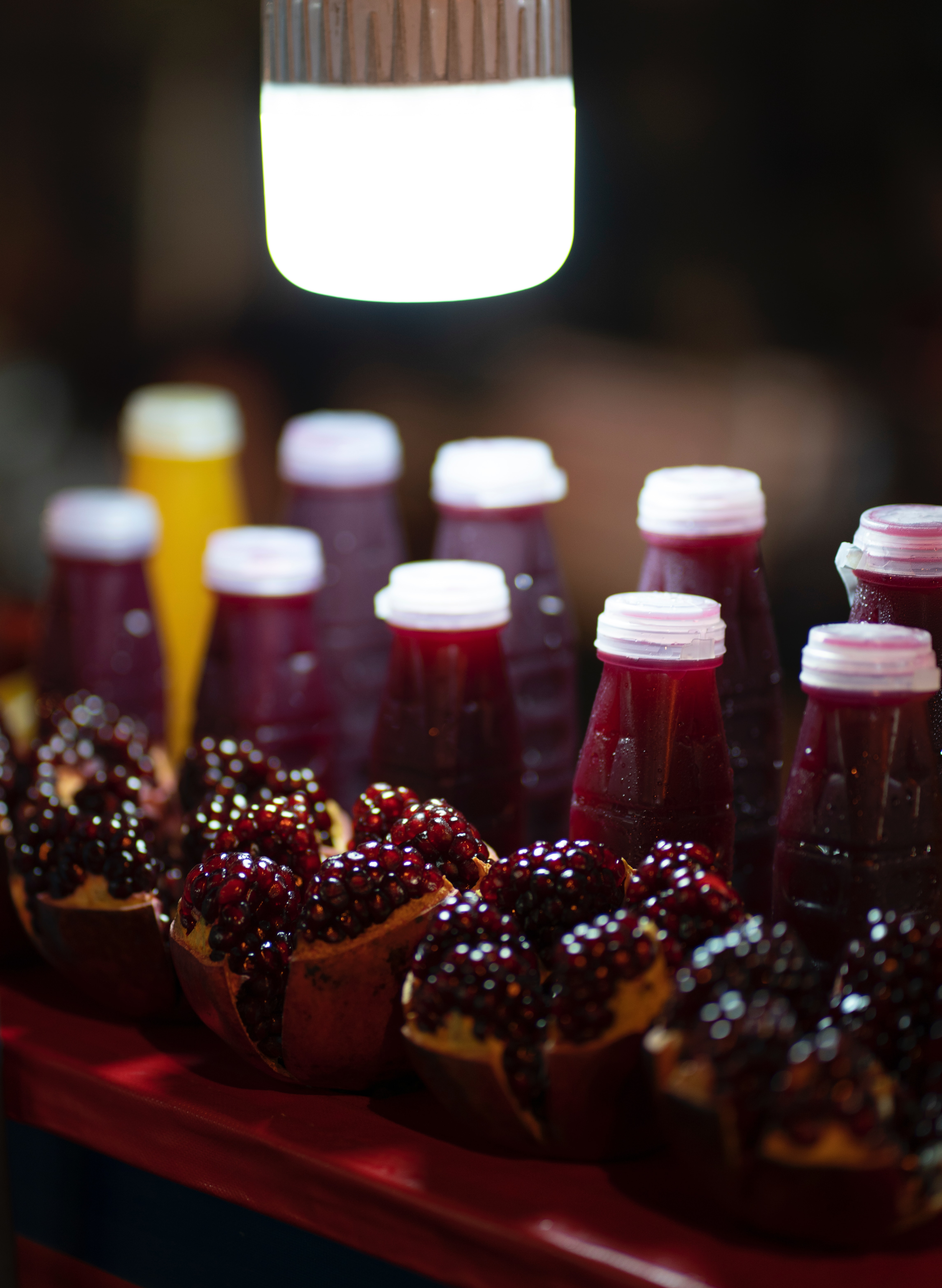 pomegranate pie near juice bottles