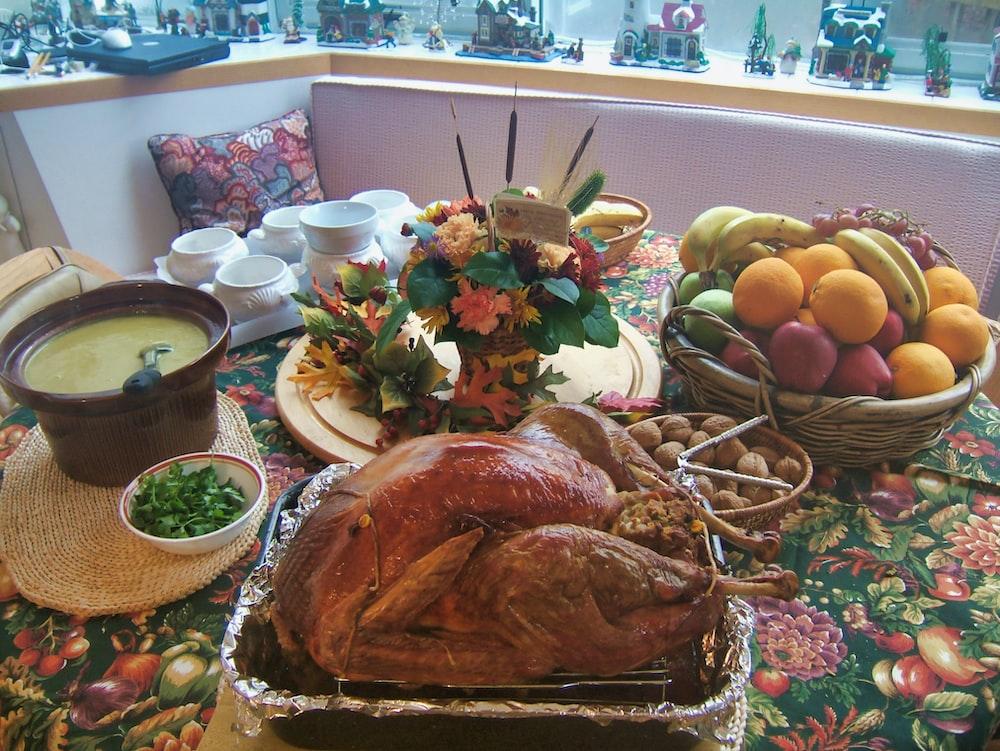 roasted chicken beside basket of fruits