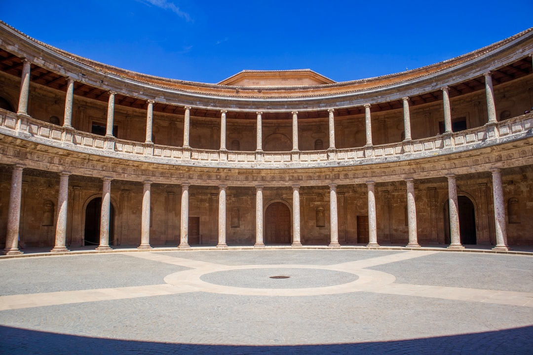 The Palace of Charles V is a Renaissance building in Granada, southern Spain, located on the top of the hill of the Assabica, inside the Nasrid fortification of the Alhambra. The building has never been a home to a monarch and stood roofless until 1957