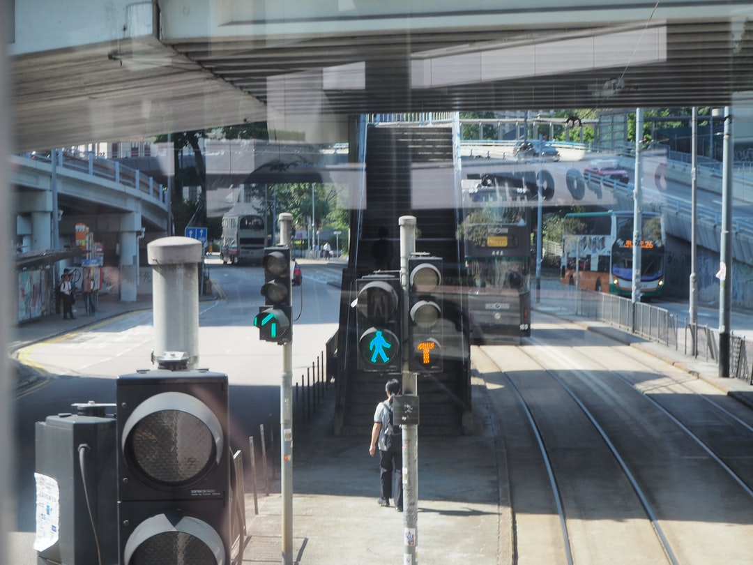 This snapshot was taken from the upper deck of tram. This is the stop of Cotton Tree Drive in Queensway, Admiralty, with the BOC building on my left and Lippo Centre on my right.
