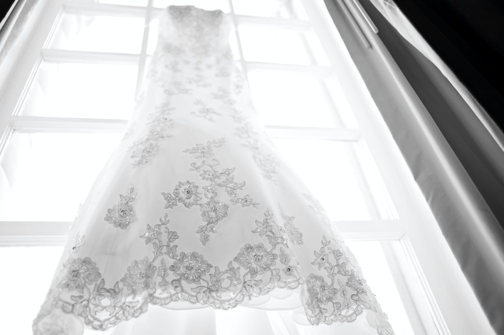 hanged white and gray wedding dress