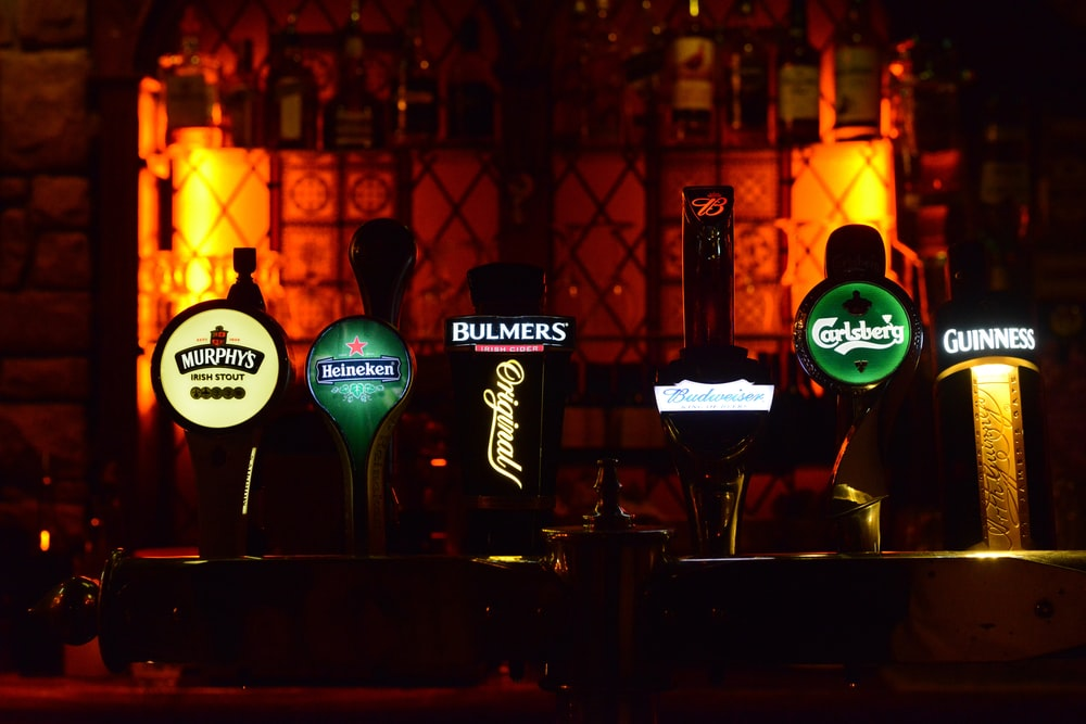 several assorted color and brand beer tap machines