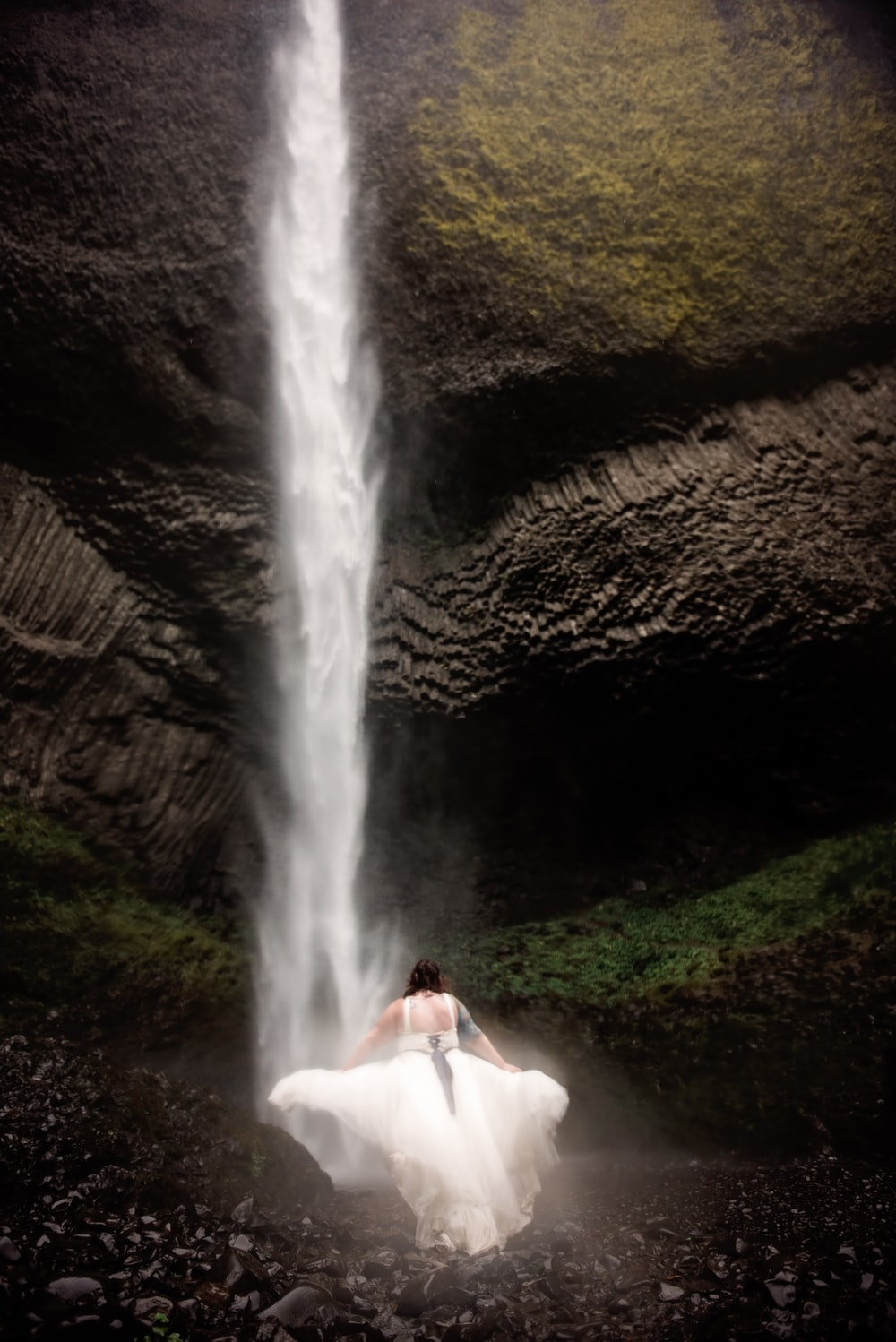 woman standing in front of waterfalls