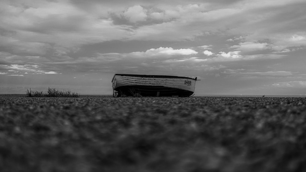 grayscale photo of boat