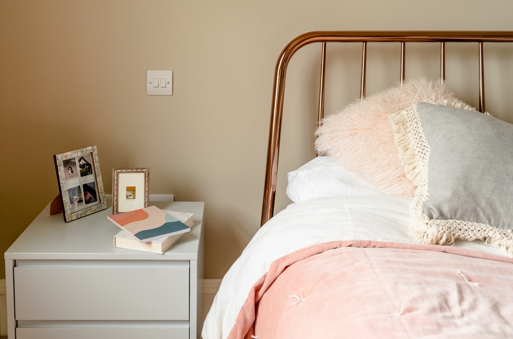 minimalist photography of a nightstand beside bed