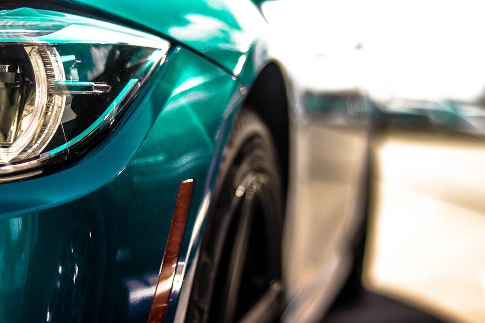shallow focus photography of green car