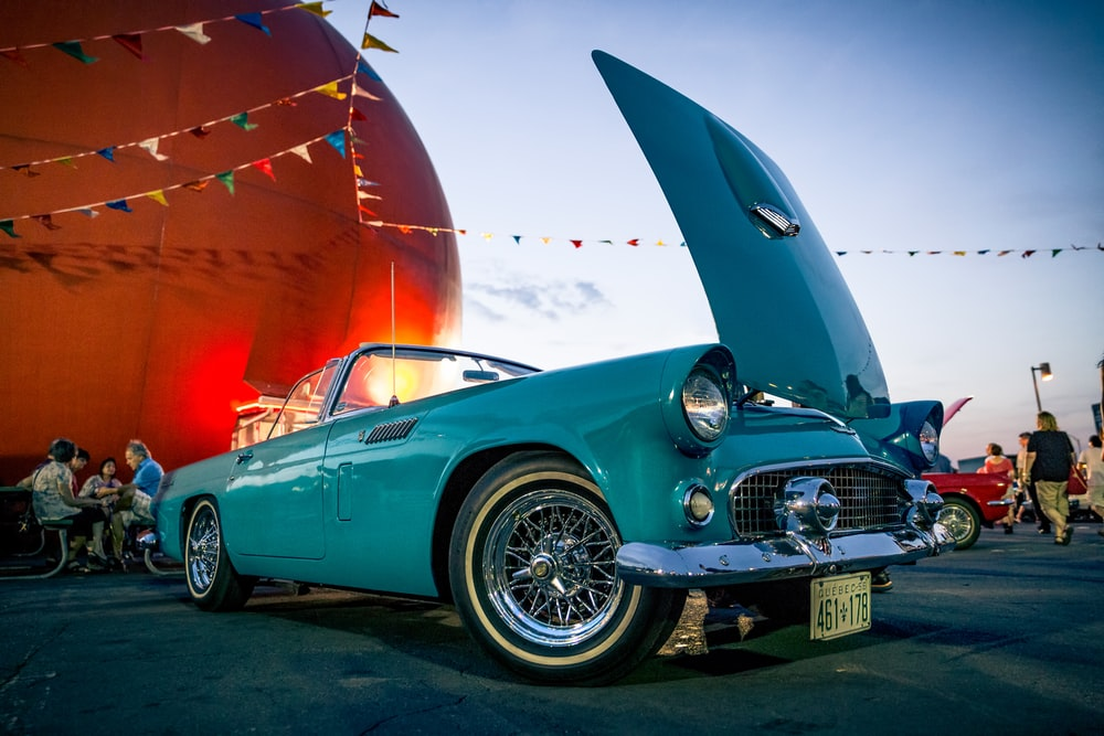 photo of teal classic vehicle