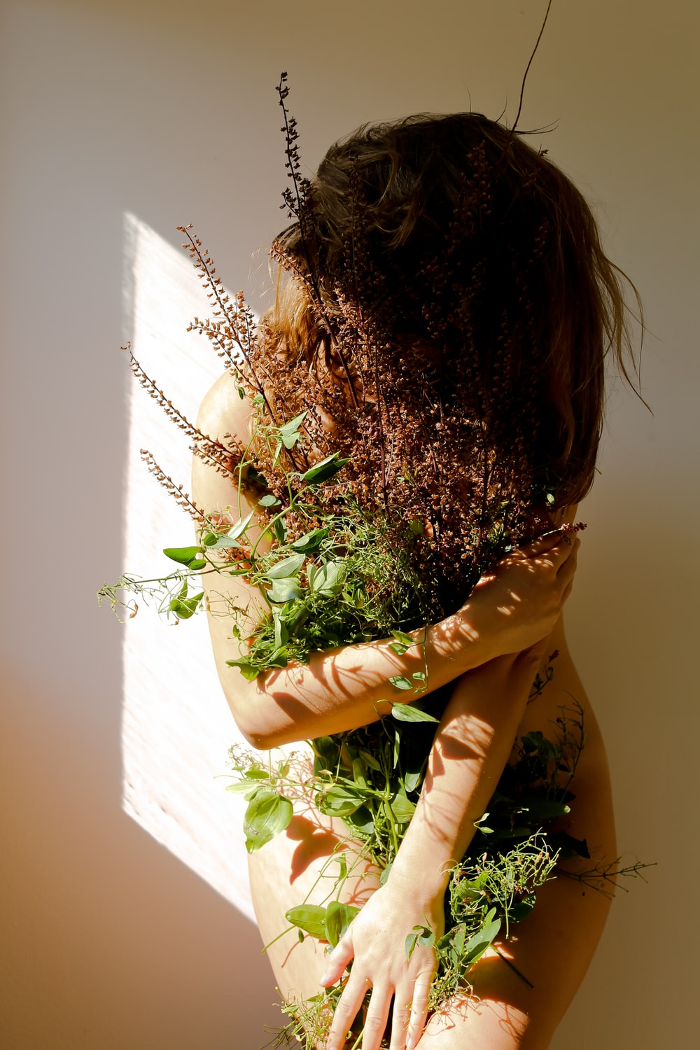 woman covered with plants