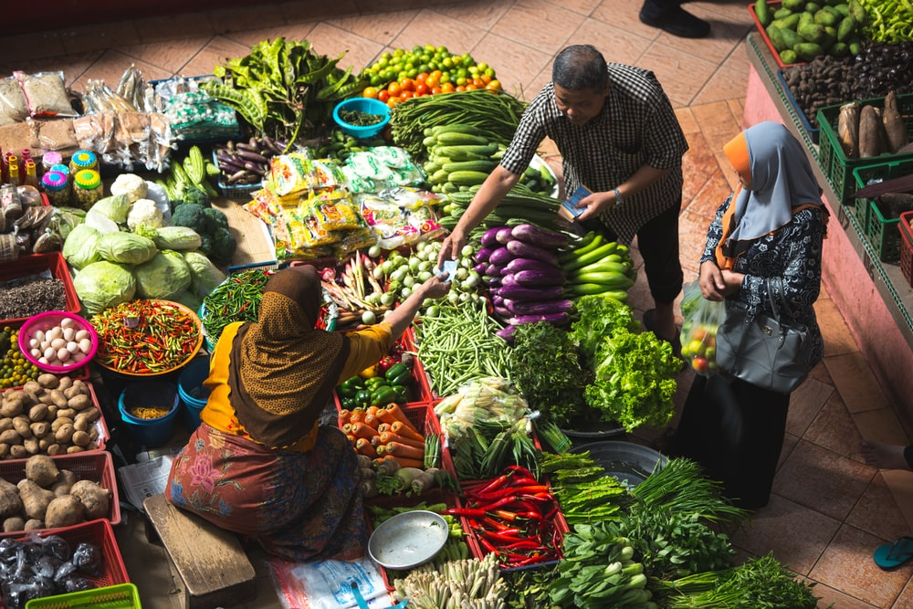 person standing near vegetables