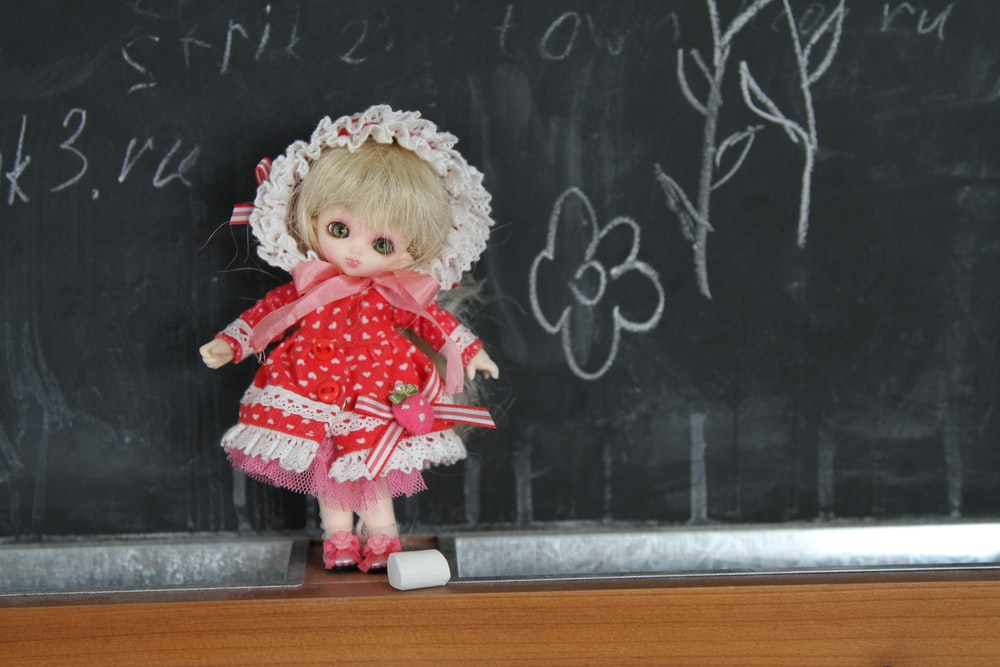 girl doll on chalkboard