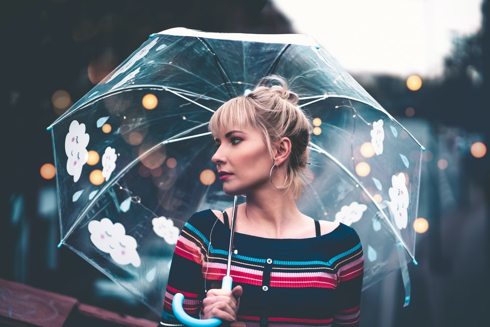 woman with translucent umbrella