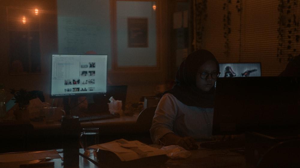 woman facing monitor