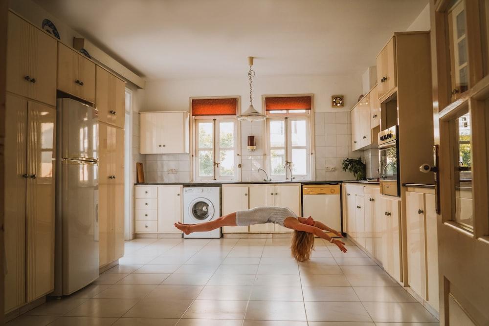 woman doing post inside kitchen