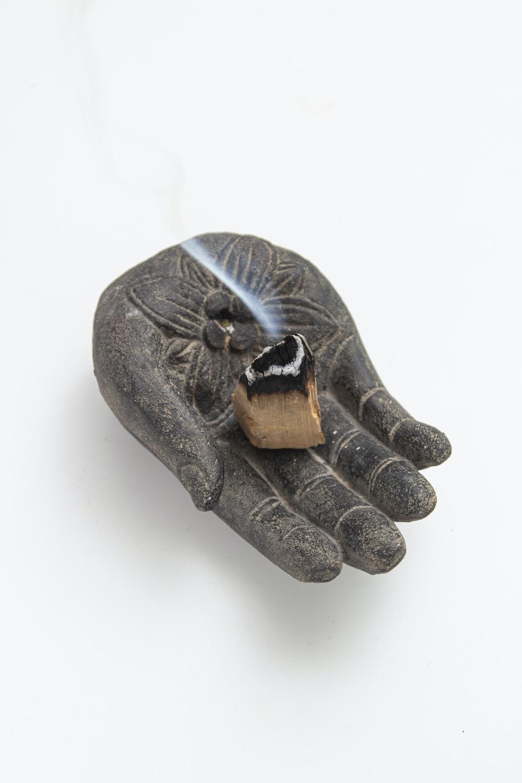 person hand flower embossed holder