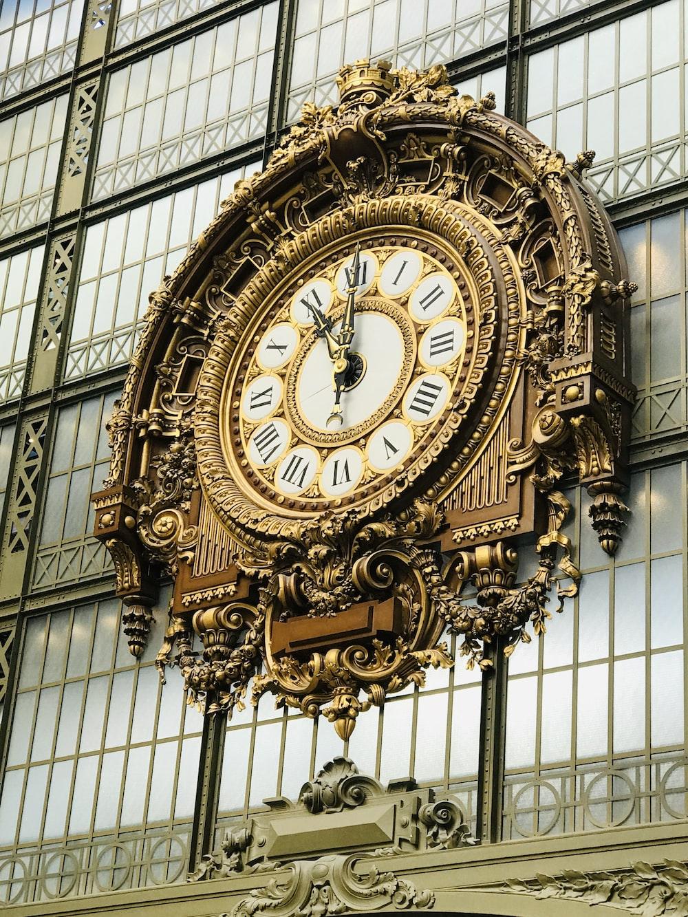 gold and white decorative analog clock