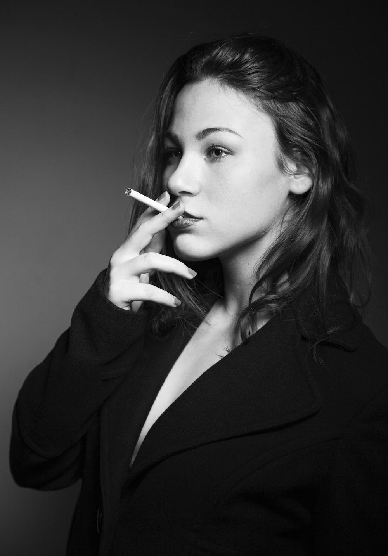 woman wearing black blazer smoking