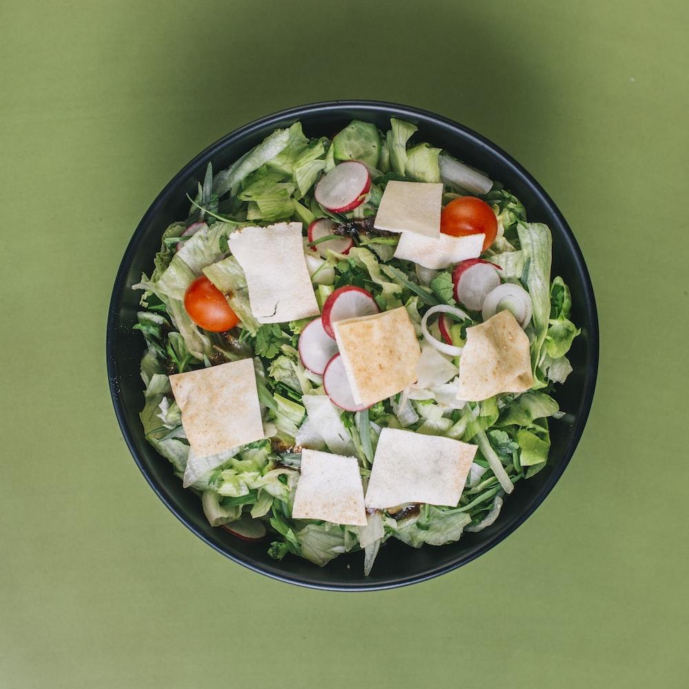 green salad on a black bowl