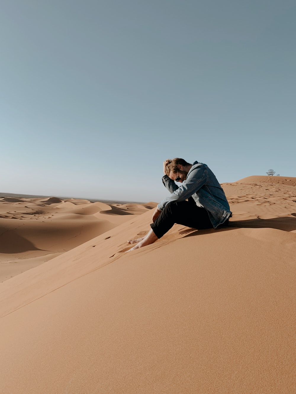 man at a desert sand dune